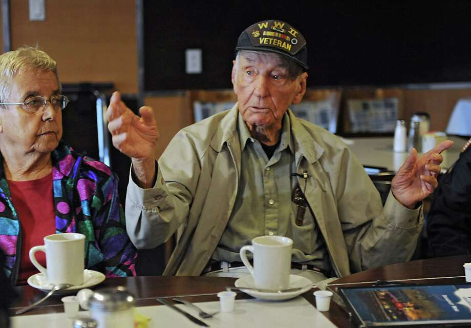 Tears fill the eyes of WW ll Navy veteran Frank Luksa of Delanson as he talks about his memories during a D-Day Breakfast Club meeting at the Gateway Diner Friday, June 6, 2014 in Albany, N.Y.  A small group of veterans gathered on the 70th Anniversary of the invasion to view videos at the diner. His wife Theresa listens next to him. (Lori Van Buren / Times Union) Photo: Lori Van Buren / 00027217A