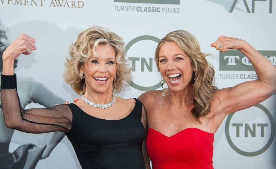 Actress Jane Fonda (L) and  Fitness expert Denise Austin arrive at the 42nd AFI Life Achievement Award honoring Jane Fonda, in Hollywood, California June 5, 2014. Photo: VALERIE MACON, AFP/Getty Images