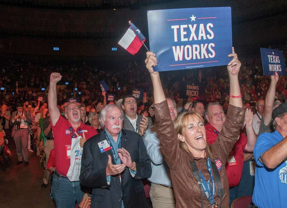 Delegates to the Texas GOP Convention cheer for Gov. Rick Perry after his speech in Fort Worth, Texas on Thursday, June, 5, 2014. In his address, the longest-serving governor in the state's history focused more on the future and national issues than his political legacy at home. Photo: Rex C. Curry, AP / FR41626AP