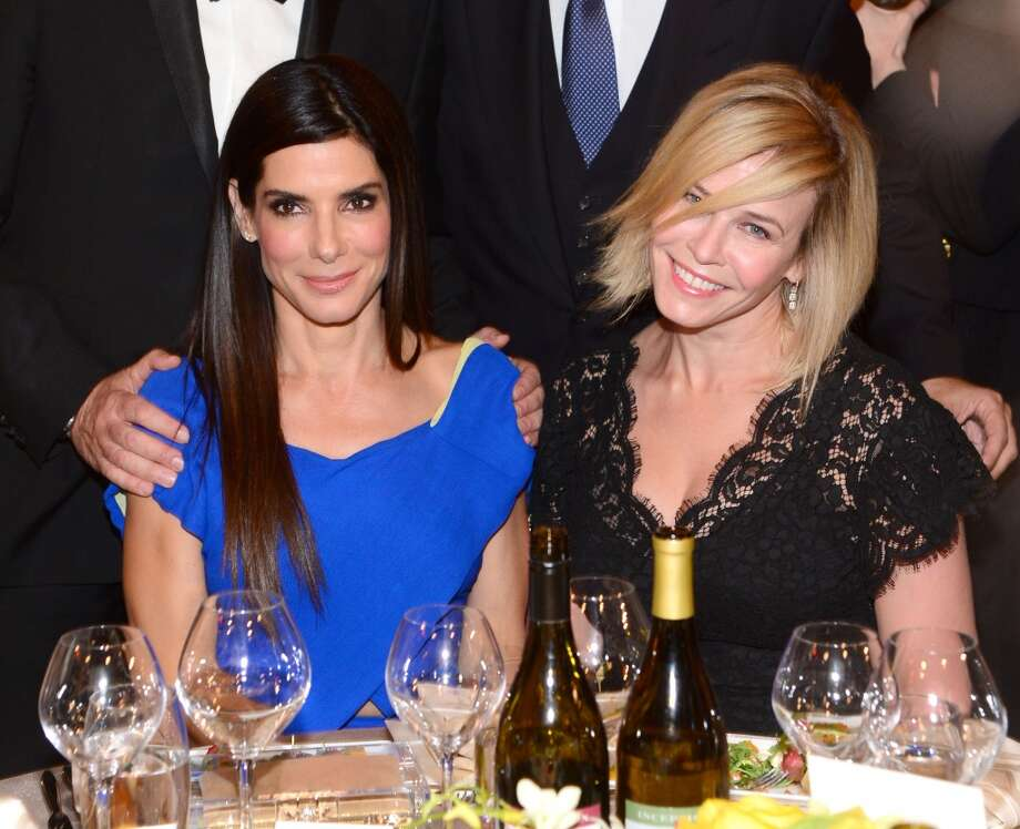 Actress Sandra Bullock (L) and TV personality Chelsea Handler attend the 2014 AFI Life Achievement Award: A Tribute to Jane Fonda at the Dolby Theatre on June 5, 2014 in Hollywood, California. Photo: Frazer Harrison, Getty Images For AFI
