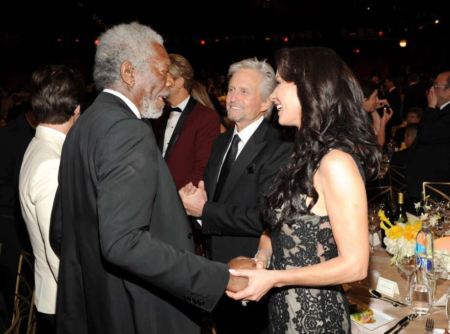 (L-R) Actors Morgan Freeman, Michael Douglas and Catherine Zeta-Jones attend the 2014 AFI Life Achievement Award: A Tribute to Jane Fonda at the Dolby Theatre on June 5, 2014 in Hollywood, California. Photo: Kevin Mazur, WireImage