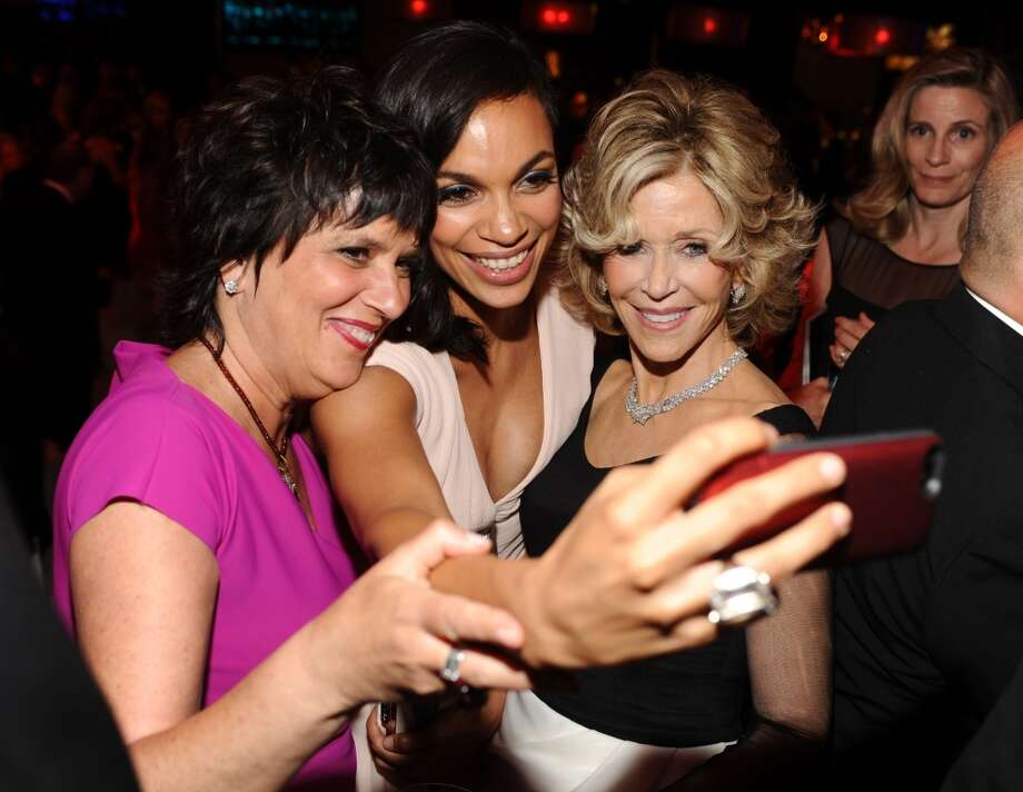 (L-R) Writer Eve Ensler, actress Rosario Dawson and honoree Jane Fonda pose for a selfie photo during the 2014 AFI Life Achievement Award: A Tribute to Jane Fonda after party at the Dolby Theatre on June 5, 2014 in Hollywood, California. Photo: Stefanie Keenan, WireImage