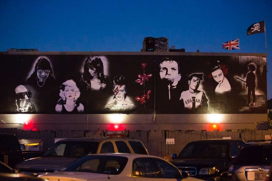Artist Rene Fernandez is currently painting a mural on the west side of nightclub Numbers in Montrose, featuring the faces of some of the most popular punk, glam, and goth artists to ever come pulsing from the sound system at the club. Some of the artists even graced the stage of the venue on their way up the ladder of fame. Photo: Eric Kayne, For The Chronicle