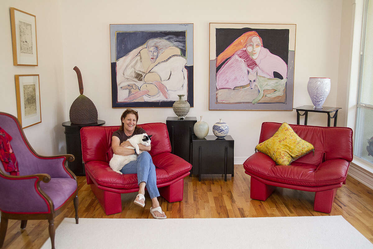 Lynda Billa Burke and Leo enjoy their colorful home in Alamo Heights. Light and art fill the house.