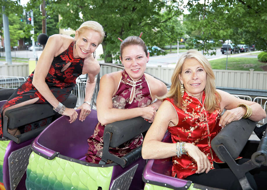 """Co-chairs of """"Chinatown: Night of the Dragon,"""" Family Centers' annual benefit, were, from left, Ann Croll, Merrilou Hillenbrand and Pam Caffray. The event, which was held recently at Greenwich Armory, raised more than $500,000 for Family Centers' human service, health and education programs. Photo: Elaine Ubina/Contributed Photo, Contributed Photo / Greenwich Time Contributed"""