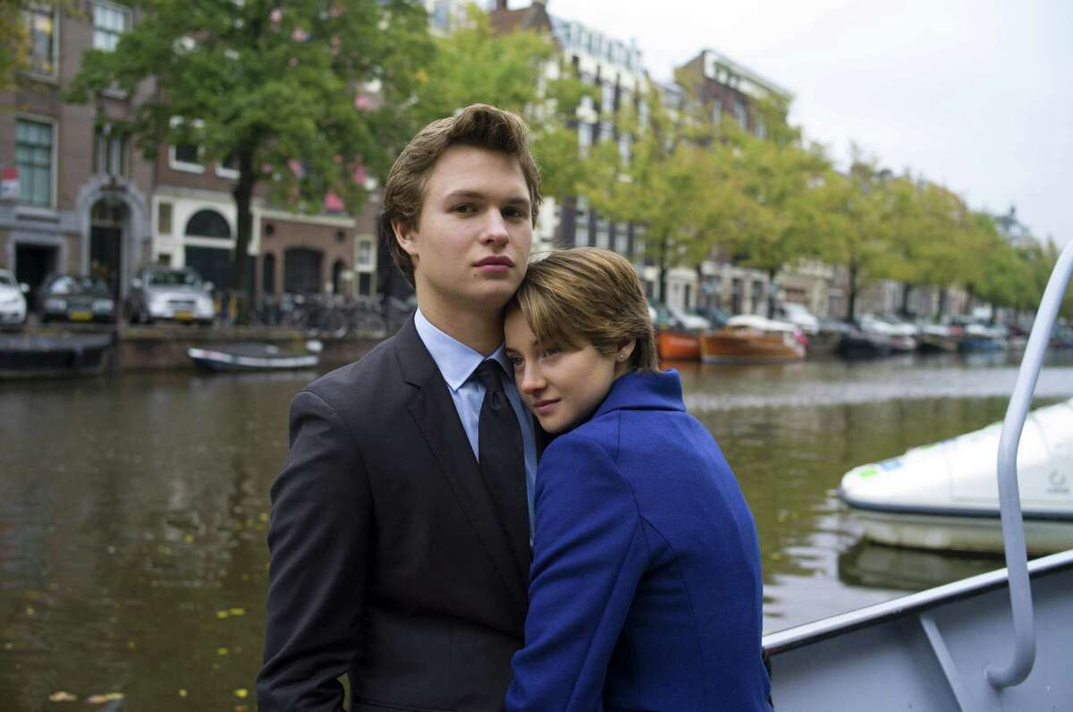 This image released by 20th Century Fox shows Ansel Elgort, left, and Shailene Woodley appear in a scene from
