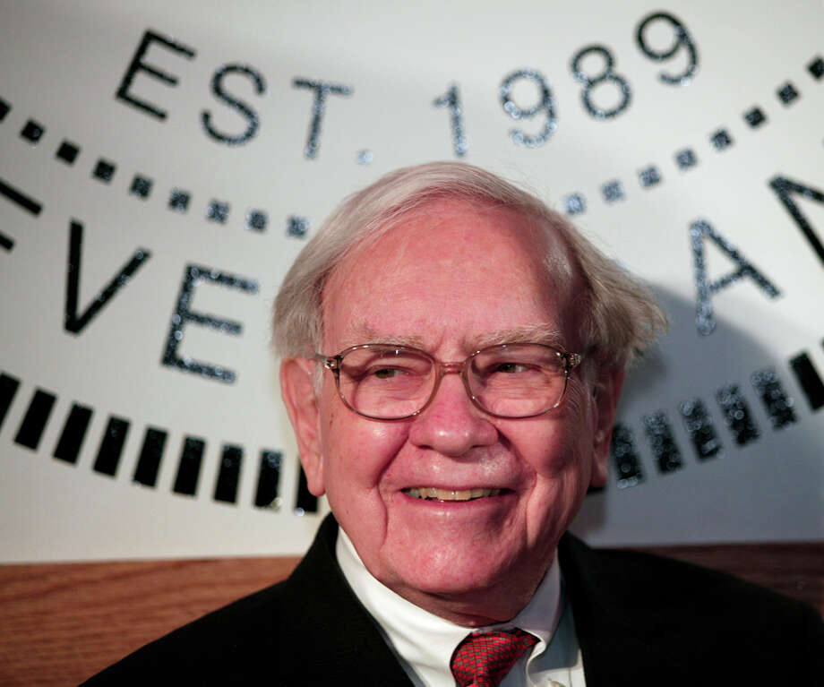 Berkshire Hathaway Chief Executive Warren Buffett (worth $63.5 billion) is well known for his attachment to Omaha, Neb. Photo: Bill Pugliano, Getty Images / 2013 Getty Images