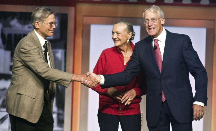 That would be the Waltons, owners of Walmart. Their collective worth is $154.8 billion. Shown here are, from left, Jim, Alice and Robson Walton. Photo: April L Brown, Associated Press