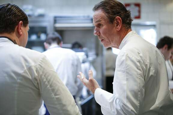Chef Thomas Keller talks with David Breeden, Chef de Cuisine, in The French Laundry's kitchen on Wednesday, April 16, 2014 in Yountville, Calif.