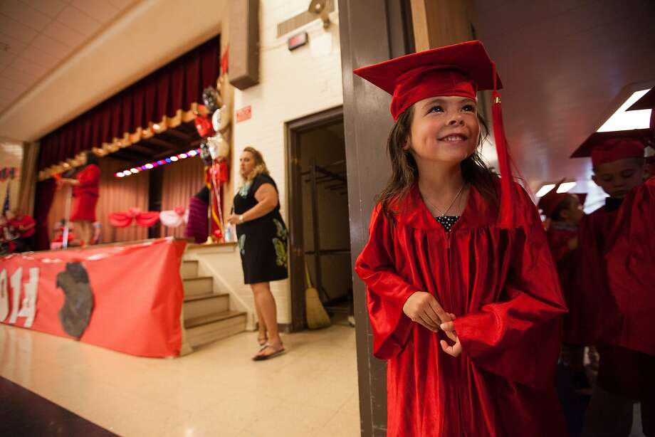 But first, the awarding of the Phi Beta Kappa keys for finger painting: Alizabeth Young-Garcia is 