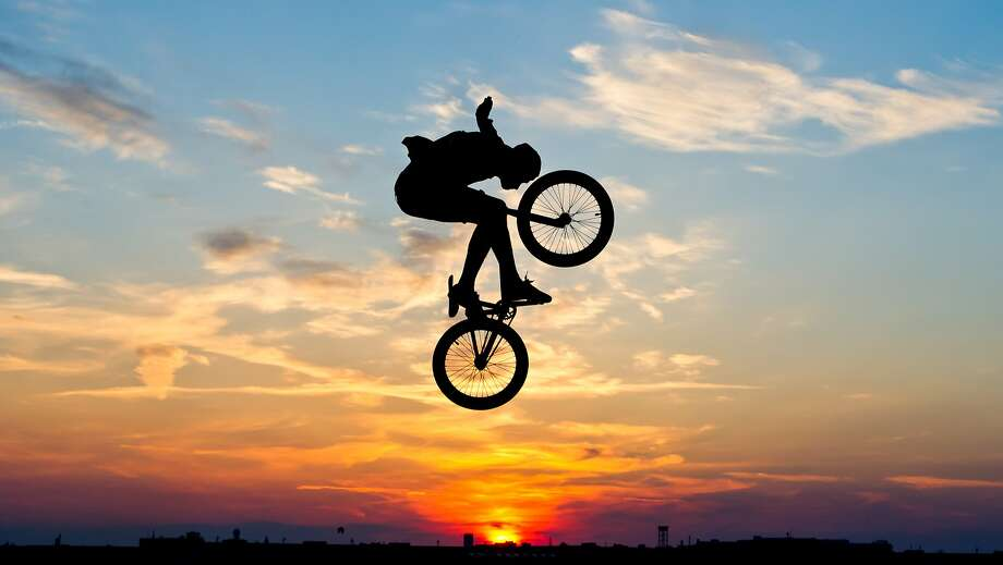 Head over wheels: A stunt cyclist jumps his BMX freestyle bike in Berlin. Photo: Ole Spata, Associated Press