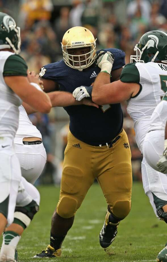 3rd round (83rd overall): Louis Nix, DT, Notre Dame, 6-2, 331.  Strengths – Projected as a first-round pick (some thought he might go as high as No. 10 to the Titans) because nobody has ever looked more like the prototypic 21st century nose tackle, he stubbornly occupies a lot of space in the center of the scrum, showing remarkably explosiveness off the ball and agility for a man of his girth. He uses his strong hands well, has an eye for the ball and he plays hard with a sometimes angry edge. Photo: Jonathan Daniel, Getty Images