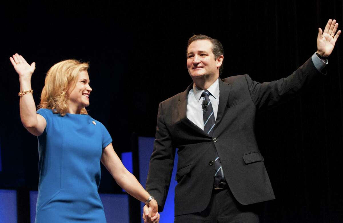 U.S. Sen. Ted Cruz, right, and his wife Heidi Nelson Cruz wave to delegates the Texas GOP Convention after his speech in Fort Worth, Texas Friday, June 6, 2014. Cruz promised to lead a conservative revolution unseen since the days of Ronald Reagan. (AP Photo/Rex C. Curry)