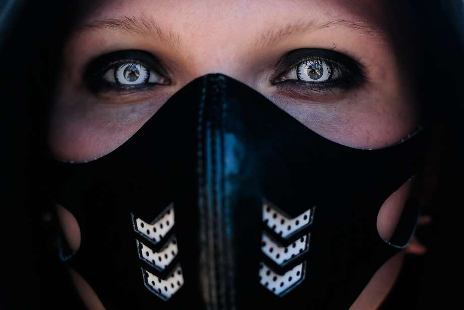 Muzzled Goth! A masked woman attends the Wave Gothic Festival in Leipzig, Germany. About 20,000 members of the Goth scene from all over the world were expected to turn out for the event. Photo: Markus Schreiber, Associated Press