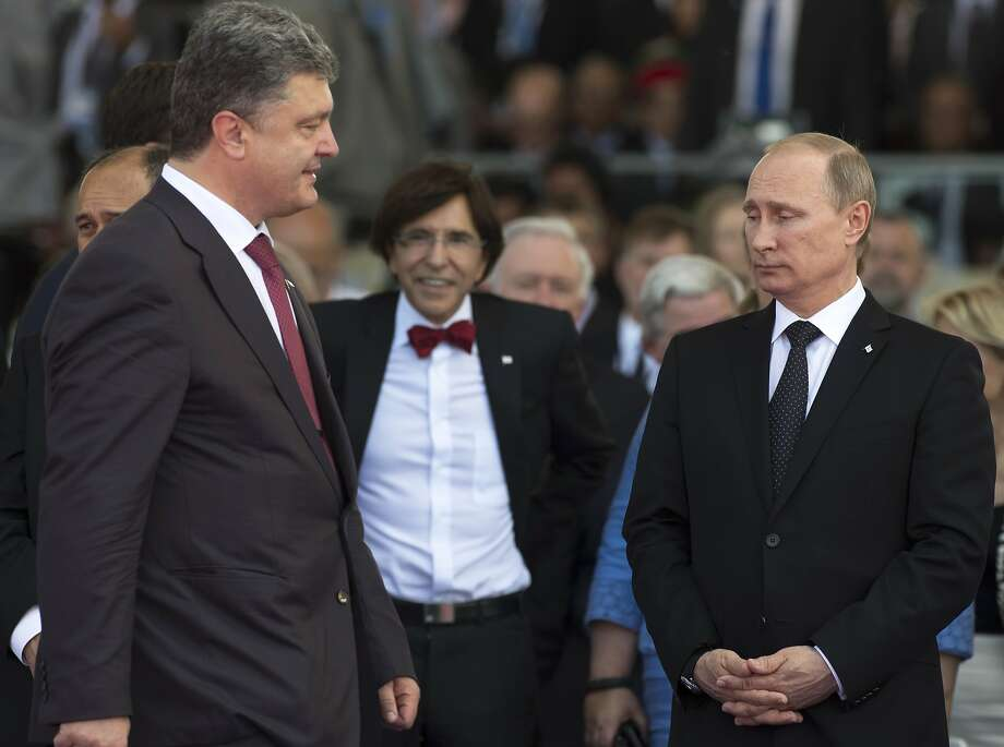 Ukraine President-elect Petro Poroshenko (left) with Vladimir Putin in Ouistreham, France. Photo: Alexander Zemlianichenko, Associated Press