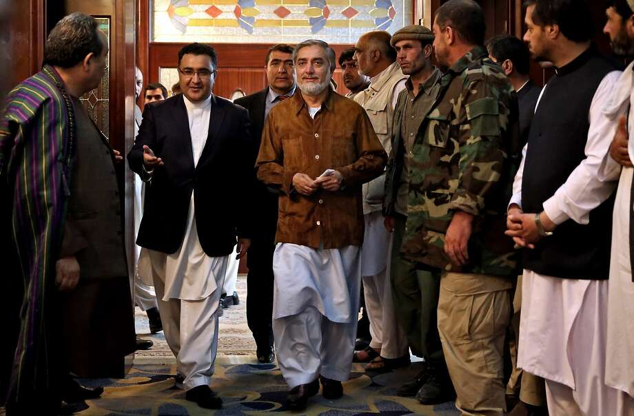 Afghan presidential candidate Abdullah Abdullah, center, arrives for a campaign rally shortly after his convoy was attacked in Kabul. Photo: Massoud Hossaini, Associated Press