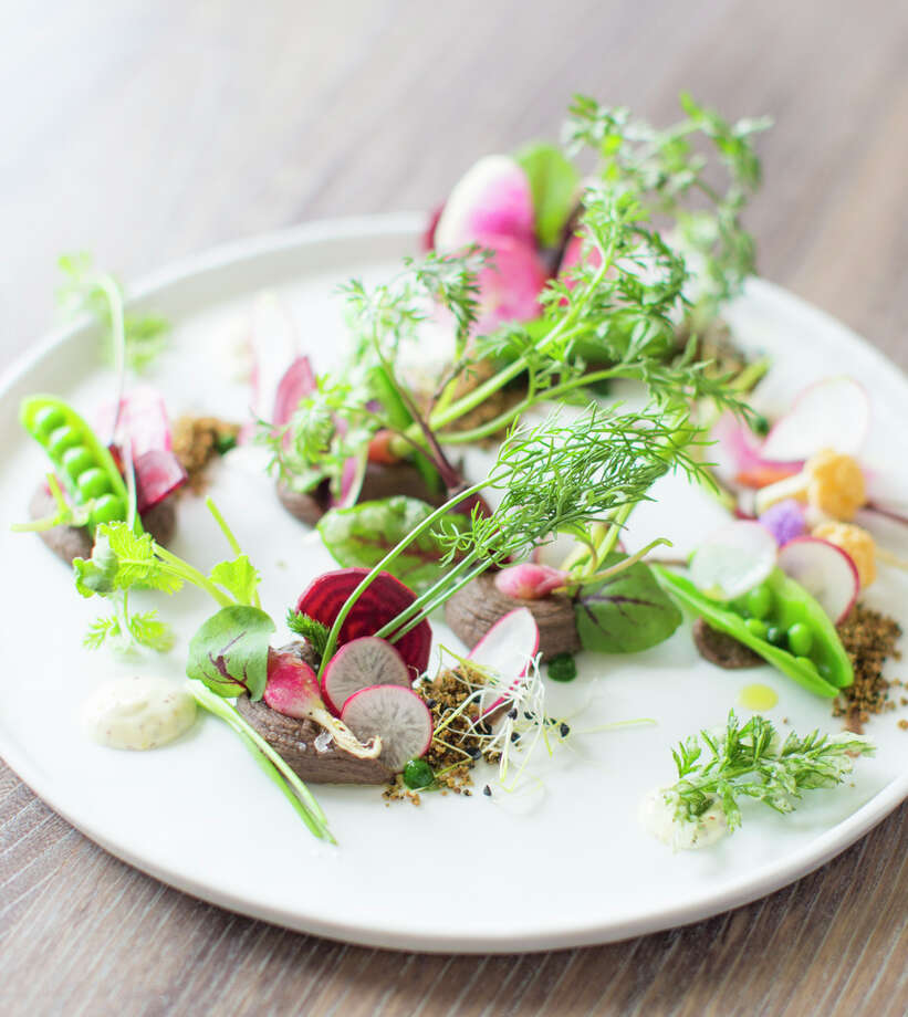 The Vegetable Garden at Aveline: Turtle bean, chicory soil, radish tops, mustard seed cream ($16) Photo: Eric Wolfinger