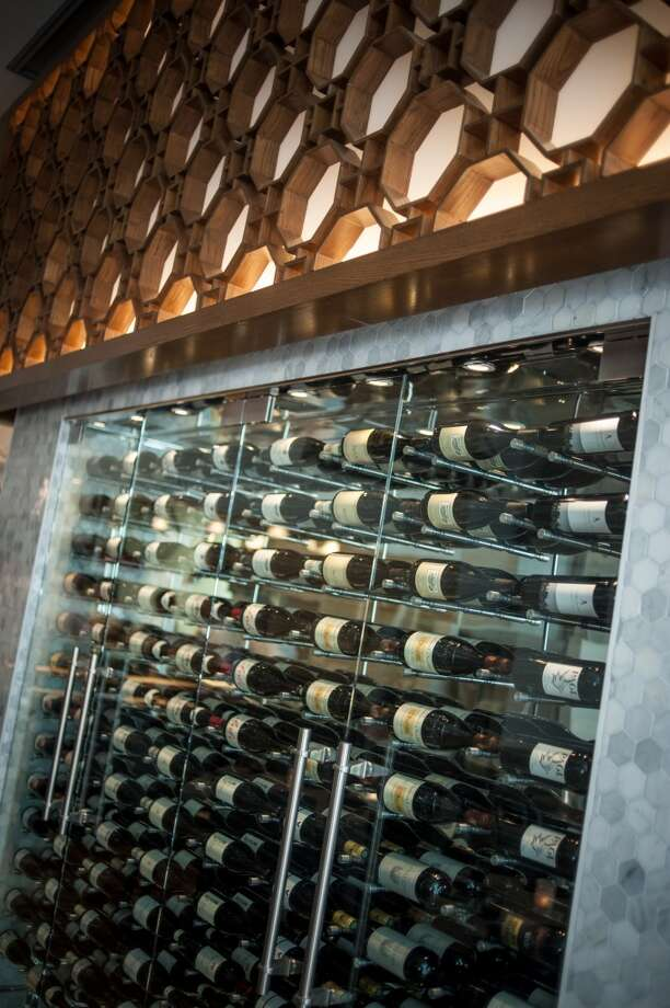 The wine wall in the middle of the dining room at Aveline. Photo: Wes Rowe