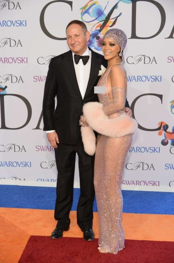 John Dempsey, President of MAC Cosmetics (left) and Rihanna attend the 2014 CFDA fashion awards at Alice Tully Hall, Lincoln Center on June 2, 2014 in New York City. Photo: Getty Images