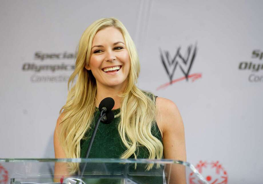 "WWE announcer Renee Young speaks during a rally in Stamford, Conn., where law enforement officers running the ""flame of hope"" across Connecticut briefly stopped to pass the torch from Stamford police officers to Darien officers on Friday, June 6, 2014. Photo: Lindsay Perry / Stamford Advocate"