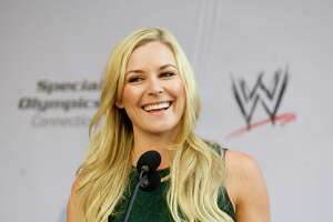 """WWE announcer Renee Young speaks during a rally in Stamford, Conn., where law enforement officers running the """"flame of hope"""" across Connecticut briefly stopped to pass the torch from Stamford police officers to Darien officers on Friday, June 6, 2014."""