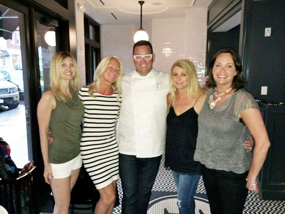 Greenwich resident's Deb Ross, MJ Weiss and Nicole Yost and Stamford resident Laurie Cingari have fun with Chef Graham Elliot at his restaurant Primary Food & Drink at the bottom of Greenwich Avenue on Tuesday. Photo: Contributed Photo / Greenwich Time Contributed
