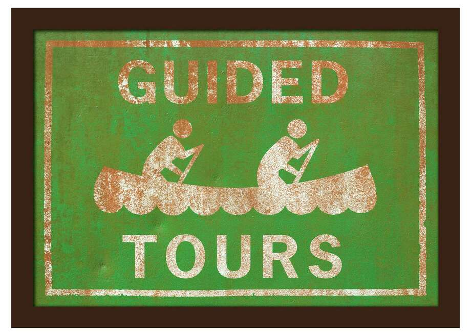 In this photo provided by One Kings Lane, Southern California-based DCR Studio created this giclee print of an retro style Guided Tours canoeing sign, mounted on wood veneer under Plexiglass. Similar styles available at www.onekingslane.com. (AP Photo/One Kings Lane) Photo: HONS / One Kings Lane