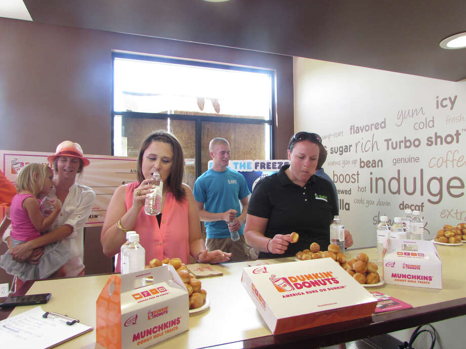"Teams of eaters at the Dunkin' Donuts in Atascocita, north of Houston, competed in the National Doughnut Day ""Donut Chowdown Challenge"" to raise money for victims of a recent fire at Sunrise Apartments in Atascocita. Ten teams with three members each competed to see which could down three dozen Dunkin' Donuts Munchkins doughnut holes the fastest. Perhaps not surprisingly, the team from the Atascocita Dunkin' Donuts had the fastest time, but waived their rights to the win over to a trio of local business owners competing as the ""Dream Team"" of Adam Rust with Liberty Mutual, Michael Jenkins with Accurate Home Design, and Darryl Ross with Prime Grime Gutterz. Photo: Dunkin' Houston"