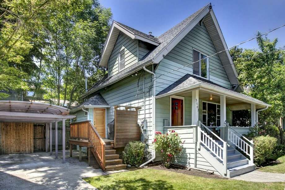 We'll start with the closest home to the median sales price, 5503 Latona Ave. N.E., which is listed for $489,000. The 1,860-square-foot house, built in 1906, has two bedrooms, full and three-quarter bathrooms, a front porch and a deck. Open houses are scheduled for 1 p.m. to 4 p.m. on Saturday and Sunday. Photo: Gregory White Photography, Courtesy Molly Cartwright/Cooper Jacobs Real Estate