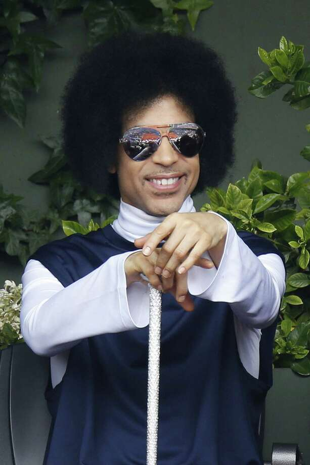 US singer Prince attends the French tennis Open round of sixteen match between Spain's Rafael Nadal and Serbia's Dusan Lajovic at the Roland Garros stadium in Paris on June 2, 2014.  AFP PHOTO / KENZO TRIBOUILLARDKENZO TRIBOUILLARD/AFP/Getty Images ORG XMIT: 492605953 Photo: KENZO TRIBOUILLARD / AFP PHOTO