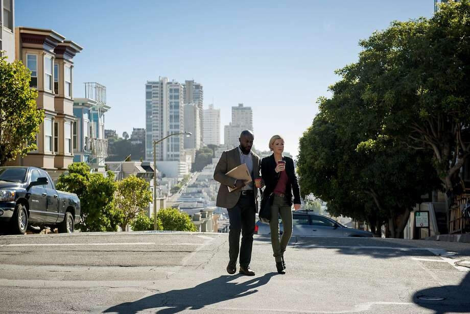 "Taye Diggs (left) and Kathleen Robertson are police partners Terry English and Hildy Mulligan in ""Murder in the First."" Photo: Eddy Chen, TNT"