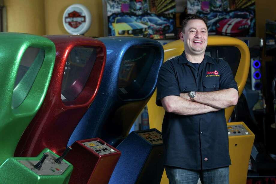 Charlie Kalas owns a video game and arcade showroom, Joystix Classic Games and Pinball, that's close to Minute Maid Park downtown. Sales of video and arcade games account for about 70 percent of the business, Kalas says. Photo: Scott Dalton, Photographer / 2014 Houston Chronicle