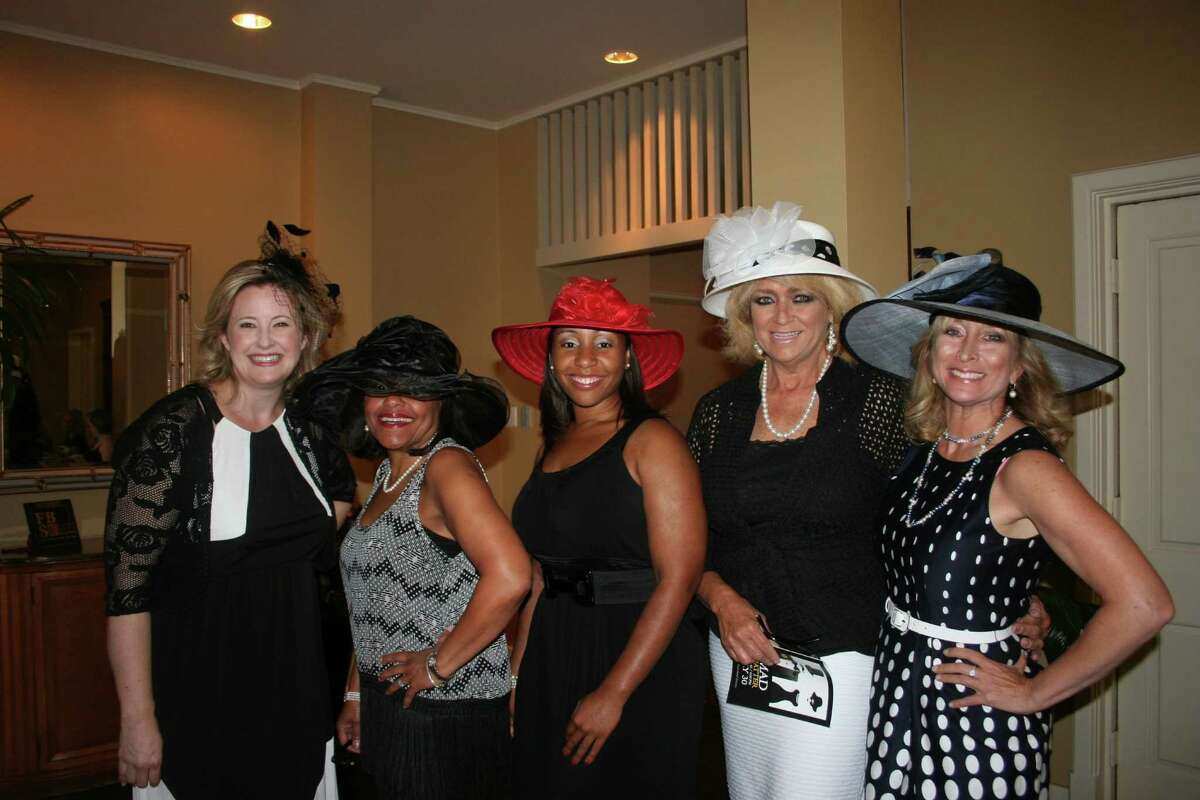 From left, Katrina Sayes, June Joseph Steele (peeking out from under her hat's brim) Camille Hicks, Caron Marble, and Sugar Land City Councilwoman Amy Mitchell wore their hats proudly.