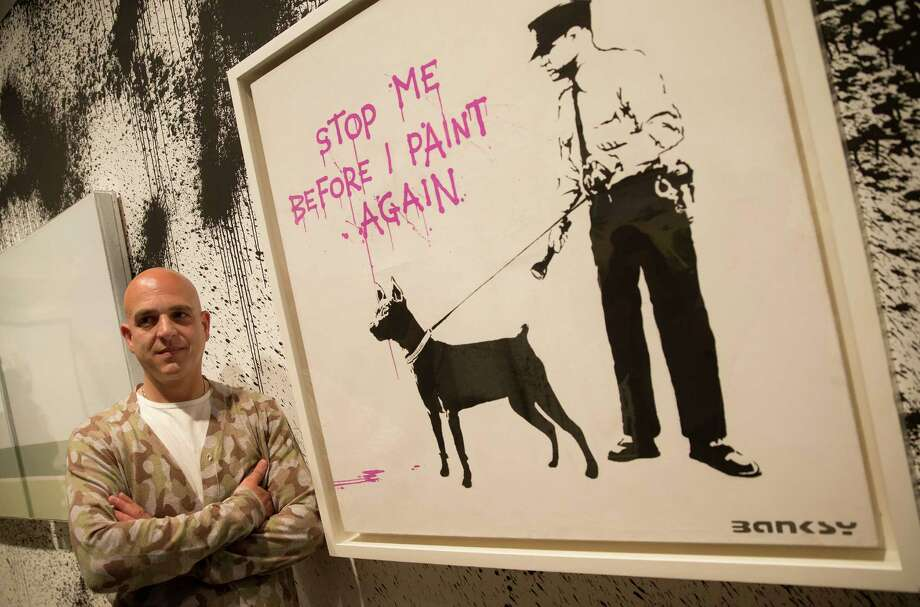 Steve Lazarides is curating an unauthorized retrospective at Sotheby's in London featuring some 70 works of art by British street artist Banksy. Photo: Alastair Grant, STF / AP