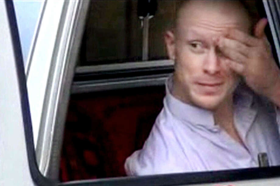 In this video image, Army Sgt. Bowe Bergdahl sits in a vehicle guarded by the Taliban in eastern Afghanistan. The Taliban released the video showing the handover of Bergdahl to U.S. forces, touting the swap of the American soldier for five Taliban detainees from Guantanamo Bay.  Photo: Voice Of Jihad Website / Voice Of Jihad Website