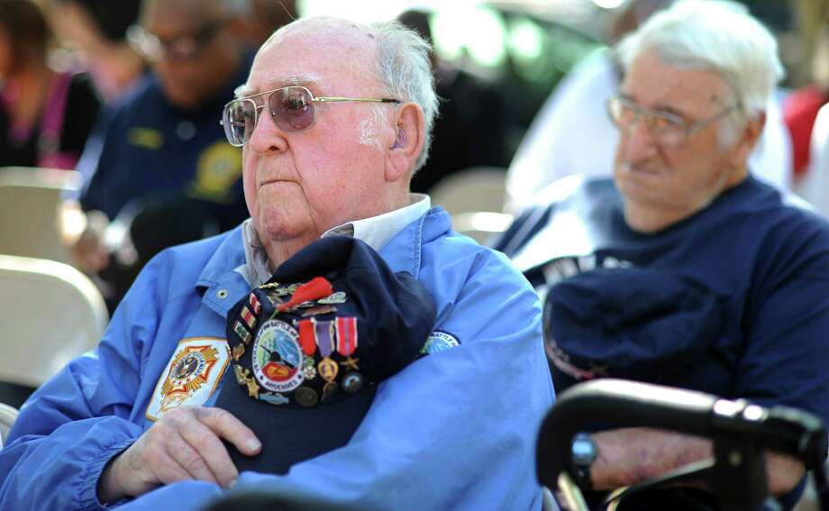 World War II veterans Joe Minto, of Bridgeport, left, and Anthony Liberto, of Fairfield, attend a ceremony to mark the 70th anniversary of D-Day Friday, June 6, 2014, at the WWII Memorial in Col. Mucci Plaza in Bridgeport, Conn. Photo: Autumn Driscoll / Connecticut Post