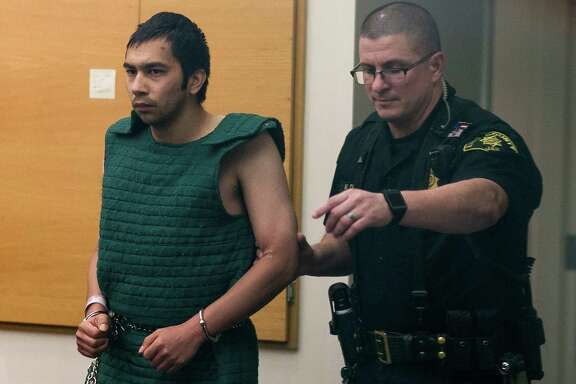 Aaron R. Ybarra, 26, suspect in the Seattle Pacific University shooting that left one dead and others injured, stands in at his bail hearing Friday, June 6, 2014, in downtown Seattle, Wash. Ybarra has a history with mental illness, and delusions as a result are said to be the reason for his actions at SPU.