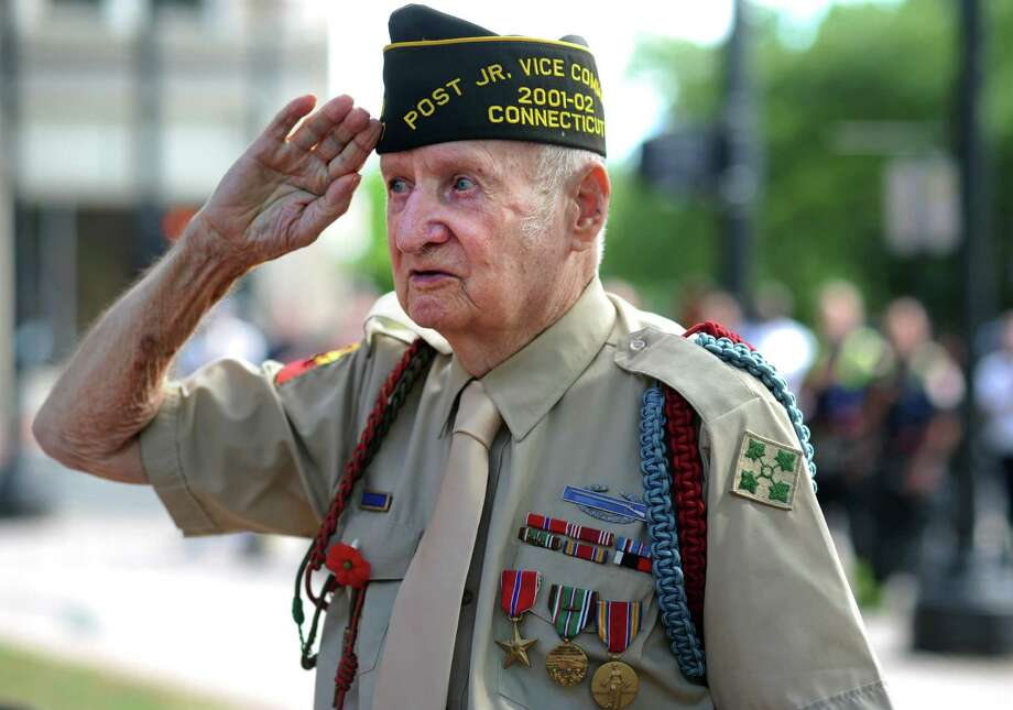 World War II veteran Frank Slovensky, of Fairfield, attends a ceremony to mark the 70th anniversary of D-Day Friday, June 6, 2014, at the WWII Memorial in Col. Mucci Plaza in Bridgeport, Conn. Photo: Autumn Driscoll / Connecticut Post