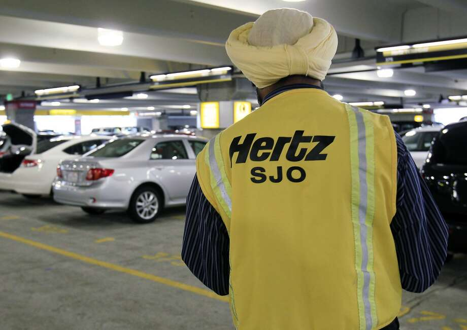 FILE - In this May 9, 2011 file photo, a Hertz rental car worker checks out cars at San Jose International Airport in San Jose, Calif. Hertz Global Holdings Inc. says it has to review its financial reports from the past three years after an audit by the car rental company found accounting errors. (AP Photo/Paul Sakuma, File) Photo: Paul Sakuma, Associated Press