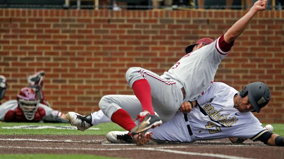 Vanderbilt's Zander Wiel slides home under Stanford pitcher John Hochstatter in the first inning. Photo: Wade Payne, Associated Press