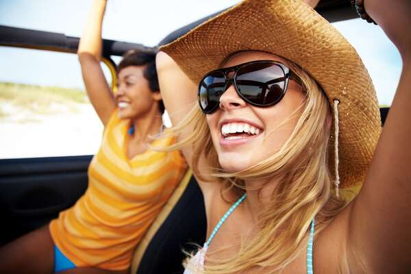 Cheerful friends enjoying a drive 