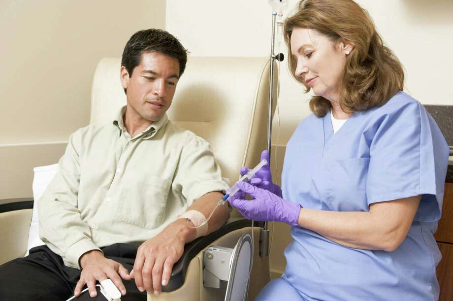Chemo infusion nurses constantly monitor patients as they receive chemotherapy. / iStockphoto