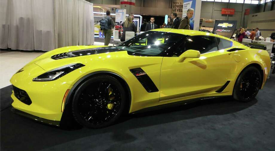 "With its blazing ""Transformers"" paint scheme, there was no chance of missing Chevrolet's hot new 2015 Z06 Corvette at the wintry Chicago Auto Show. The Z06 has plenty of ducting for cooling and aerodynamic downforce."