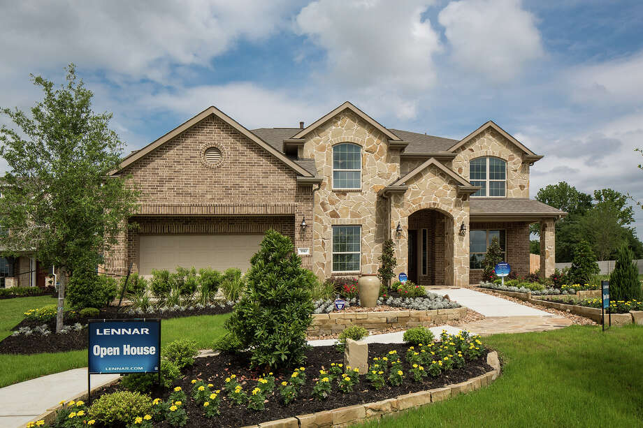 Lennar's two-story Sapphire model (shown), one of the designs from builder's Texas Reserve Collection, priced from the $340,000s, is in Falls at Green Meadows, across from the Katy City Park. / ©2013 Steve Chenn Photography