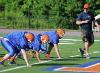New Danbury Head Coach Mark Ecke directs the defensive linemen during Danbury football practice at Danbury High School in Danbury, Conn. Friday, June 6, 2014.  The team has a new coach for the 2014 season, now led by Mark Ecke.
