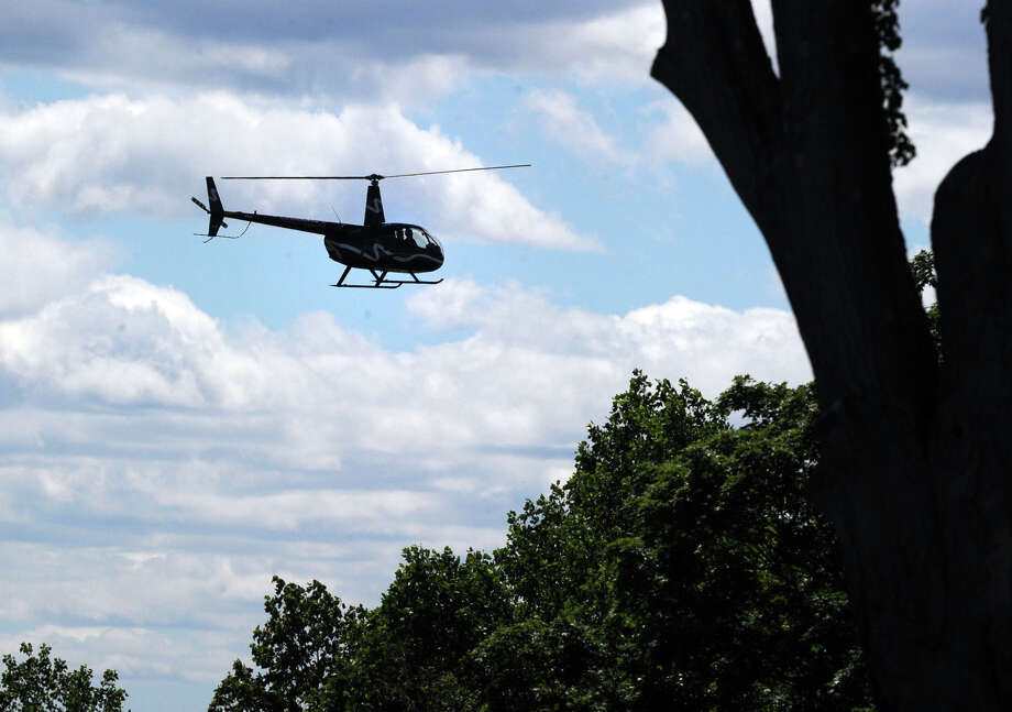 A helicopter hovers over the Convent of the Sacred Heart Commencement at the school in Greenwich, Friday afternoon, June 6, 2014. Photo: Bob Luckey / Greenwich Time