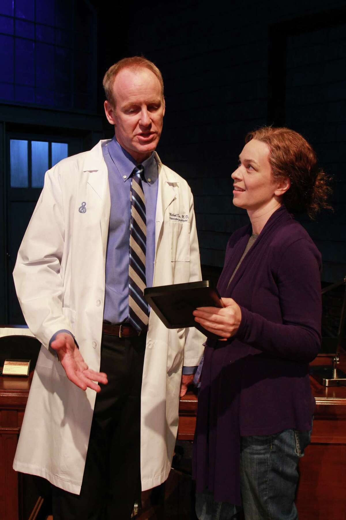 """(For the Chronicle/Gary Fountain, May 27, 2014) Chris Hutchison as Mike, and Elizabeth Bunch as Margaret, in this scene from Alley Theatre's Houston premiere of David Lindsay Abaire's award-winning play, """"Good People."""""""