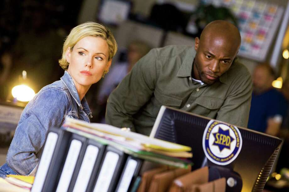 "Hildy Mulligan (Kathleen Robertson) and Terry English (Taye Diggs) are San Francisco police officers on TNT's ""Murder in the First."" Photo: Trae Patton / TM & © Turner  Entertainment Networks, Inc.  A Time Warner Company.  All Rights Reserved."