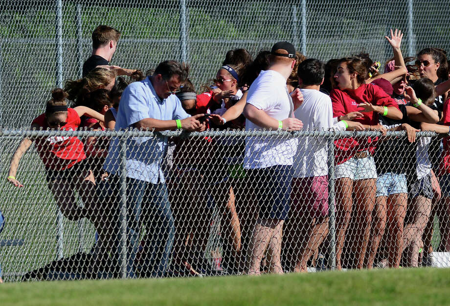 A row of bleachers full of Fairfield Warde students collapsed during the Trumbull baseball game, injuring at least three people, in Trumbull, Conn. on Friday June 6, 2014. Photo: Christian Abraham / Connecticut Post
