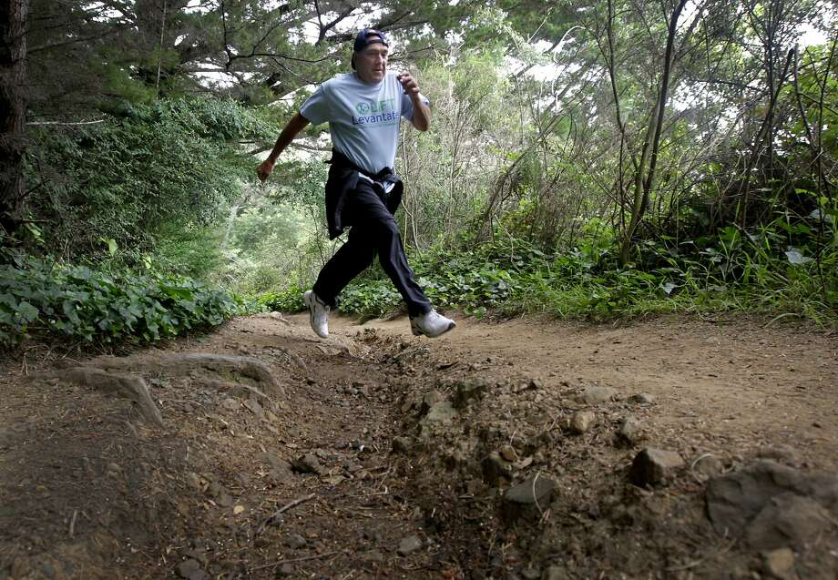 Porter Davis avoids a rutted section of the Dipsea Trail during a training run in Mill Valley, Calif. on Friday, June 6, 2014. The 80-year-old is the oldest entrant in Sunday's 7.4 mile Dipsea Race, the country's oldest trail race. Photo: Paul Chinn, The Chronicle